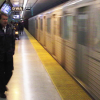 People wait to board a TTC subway train in this file photo.