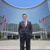 Stephen Chu, CEO of Hui Xian REIT, in front of Oriental Plaza, Beijing's most valuable retail property