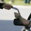 A driver hands his passport to a border agent at the U.S. border crossing in Highgate Springs, Vt., Monday, June 1, 2009.