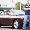Toronto restaurateur David Minicucci smiles in front of his 1973 Alfa Romeo 2000 GTV.