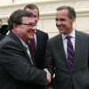 Finance Minister Jim Flaherty and Bank of Canada Governor Mark Carney during a break in testimony at the House of Commons finance committee.