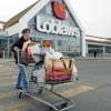 A shopper leaves a Loblaws store in St. Eustache, Que.