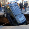 Ford Explorer nose-dived into a 20-foot sinkhole.