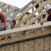 Construction workers frame a house at a new development in Ottawa. (July 9, 2008)